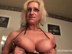 blonde-mature-in-big-tits-masturbating-cunt-with-toys-and
