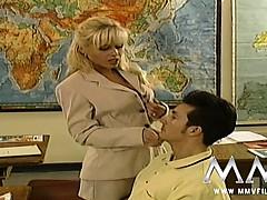 sexy-blonde-teacher-seducing-her-student-in-class