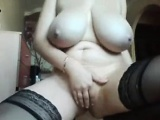 Big tit milf in stockings teases her pussy